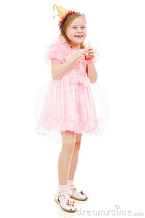 A girl in a pink dress and hat laughing