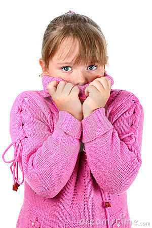 Girl in pink sweater feeling cold embracing self
