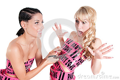 Girl in pink tape dress cuting with scissors