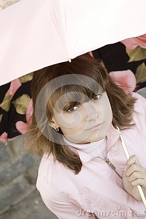 Girl in pink under the umbrella