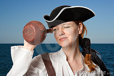 The girl-pirate looks in a jug against the sea