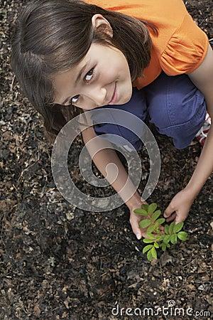 Girl Planting Black Locust Tree