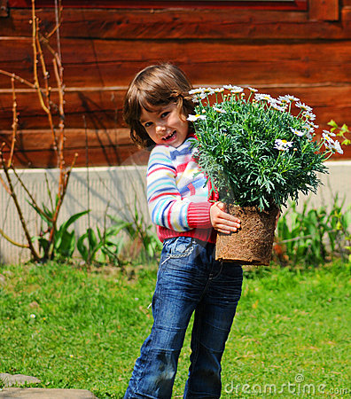 Free Girl Planting Daisies Stock Image - 9117251