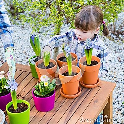 Free Girl Planting Flower Bulbs Stock Photography - 59122242