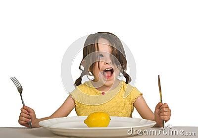 Girl with plate and lemon