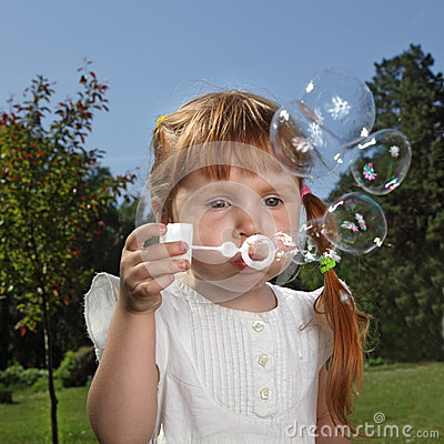 Girl play in  bubbles