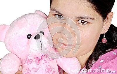 Girl play with teddy