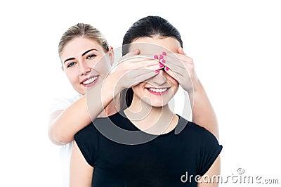 Girl in playful mood teasing her friend