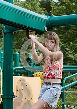 Girl On Playground Equipment Royalty Free Stock Photos