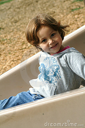 Girl on playground slide