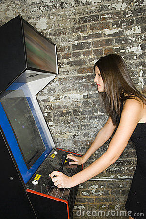 Girl Playing an Arcade Game