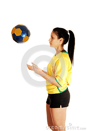Girl playing with ball.