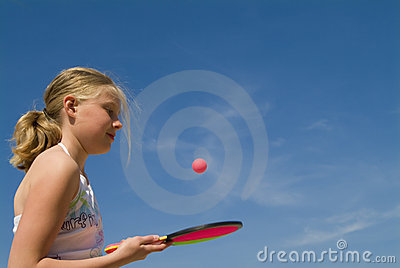 Girl playing a ball game