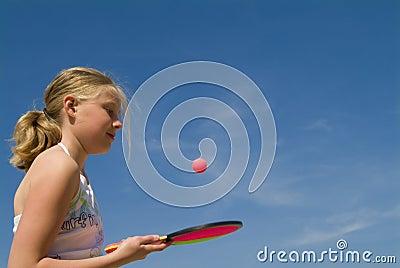 Girl playing a ball game