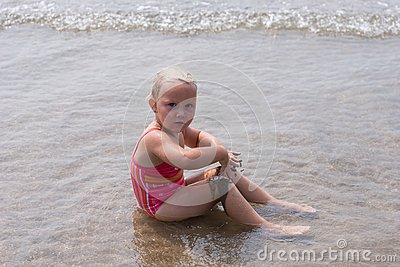 Girl playing at the Beach