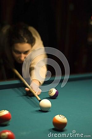 Girl playing billiard