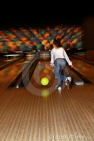 Girl playing bowling