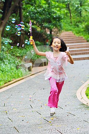 Girl playing bubble