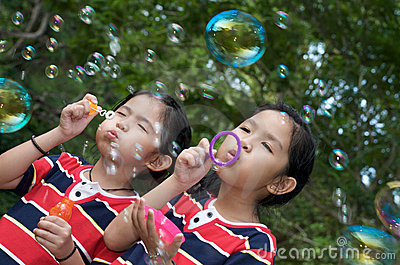 Girl playing bubble at park