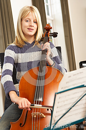 Free Girl Playing Cello At Home Royalty Free Stock Photo - 25392295