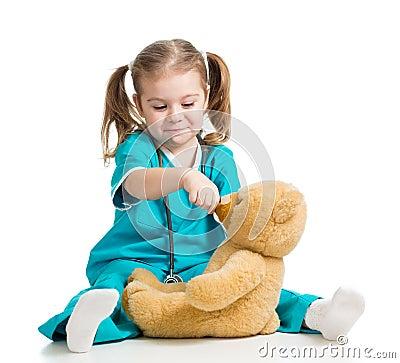 Free Girl Playing Doctor And Spoon Feeding Teddy Bear Ov Stock Photos - 28544583
