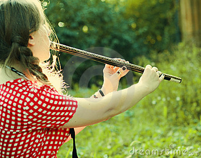 Girl playing at the flute