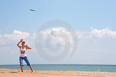 Girl playing frisbee