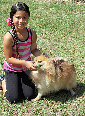 Girl playing with her dogs