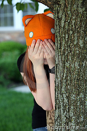Girl playing hide and go seek