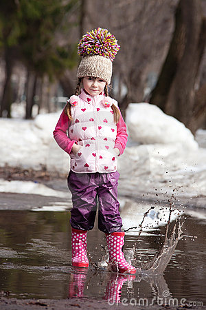 Free Girl Playing In Puddles Stock Photography - 22876412