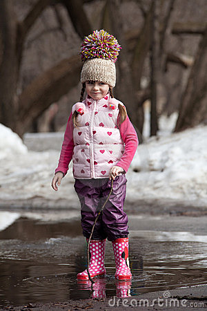 Free Girl Playing In Puddles Royalty Free Stock Photography - 22876437