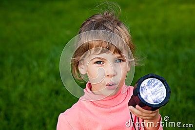 Girl playing with lantern