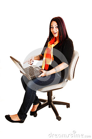 Girl playing with laptop.