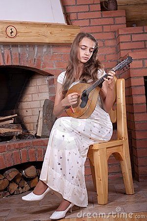 Girl playing on Mandolin