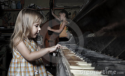 Girl playing on an old  piano