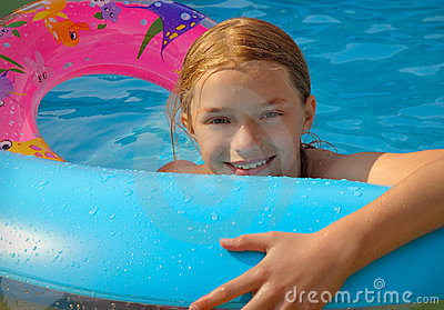 Girl playing in paddling pool
