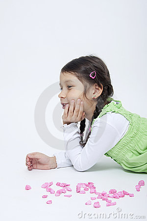 Girl playing with pink grit