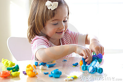 Girl playing with play dough