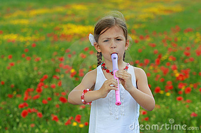 Girl playing the recorder