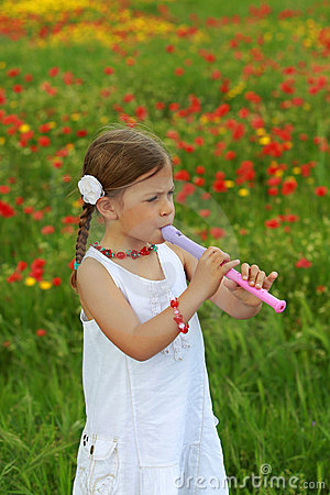 Girl playing a recorder (flute)