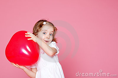 Girl playing with red balloon