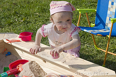 Girl playing in sandbox