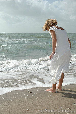 Girl playing by sea