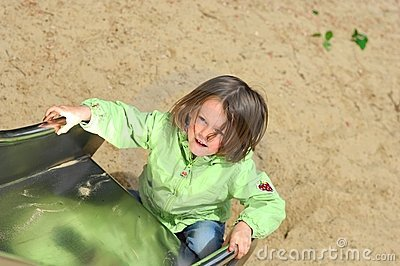 Girl playing on slide