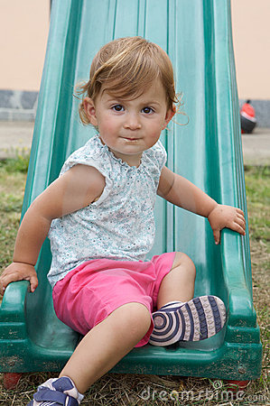 Girl playing on a slide