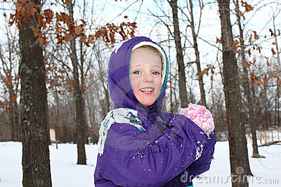 Girl playing in the snow