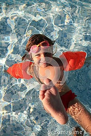 Girl playing in swimming pool