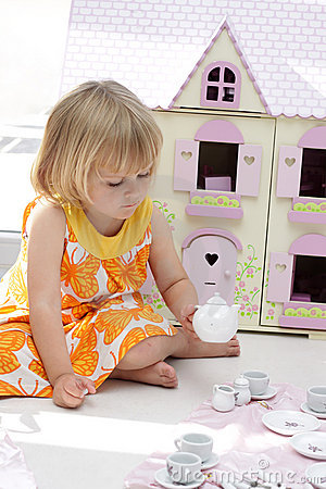 Girl playing tea party