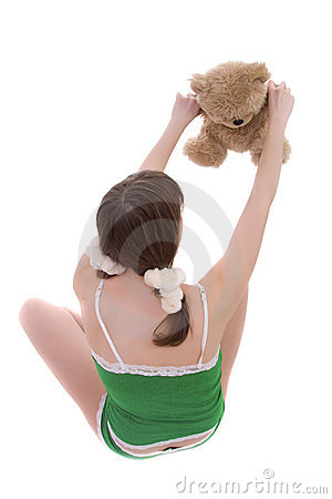 The girl playing with teddy bear.