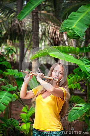 Free Girl Playing The Bamboo Flute Stock Photos - 24716023